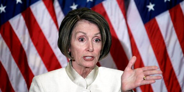 House Speaker Nancy Pelosi gestures during a news conference on Capitol Hill June 24. (AP Photo)