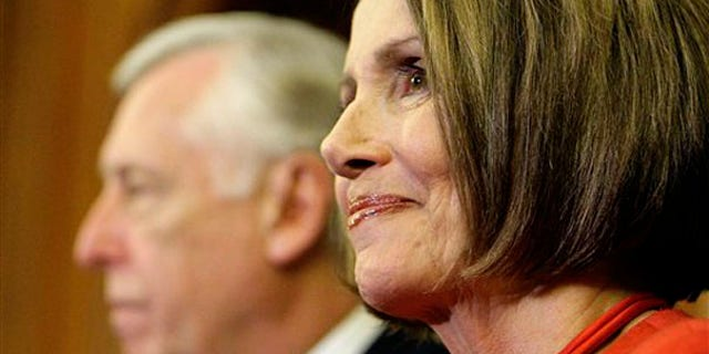 Speaker Nancy Pelosi smiles at a press conference at the U.S. Capitol Nov. 7, as House Majority Leader Steny Hoyer looks on. (AP Photo)