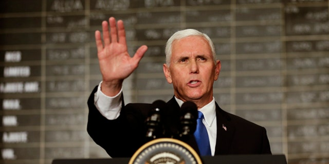 U.S. Vice President Mike Pence waves after speaking at the Buenos Aires Stock Exchange, in Argentina, Tuesday, Aug. 15, 2017. Pence is on a official visit to Argentina until Wednesday, when he will be heading to Chile on a week-long visit to Latin America. (AP Photo/Victor R. Caivano)