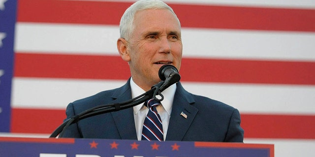 Republican vice presidential candidate Mike Pence addresses a crowd during a rally, Thursday, Oct. 6, 2016 in Johnstown, Pa. (John Rucosky/The Tribune-Democrat via AP)