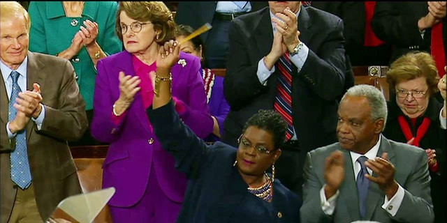 Jan. 20, 2015: Rep. Gwen Moore, D-Wis. waves a pencil in solidarity with the Charlie Hebdo victims during President Obama's State of the Union address.