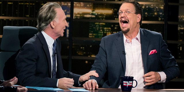 """In this Friday, Aug. 18 , 2017 photo provided by HBO, Penn Jillette, right, appears on Bill Maher's """"Real Time,"""" in Los Angeles. Jillette is apologizing profusely for his wisecracks insulting Newfoundland. The talkative half of the Penn & Teller magic and comedy act called Newfoundland, quote, """"a euphemism for stupid"""" during Friday's """"Overtime with Bill Maher,"""" an online follow-up to Maher's weekly """"Real Time"""" talk show on HBO."""