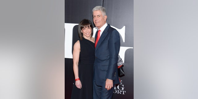 """In this Nov. 23, 2015, file photo, chef and television personality Anthony Bourdain and wife Ottavia Busia attend the premiere of """"The Big Short"""" at the Ziegfeld Theatre in New York."""