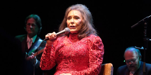 FILE - In this Aug. 28, 2016 file photo, Loretta Lynn performs in concert at the American Music Theater in Lancaster, Pa. Lynn has postponed shows after suffering injuries in a fall that will require minor surgery. Her injuries were described as not serious, but a statement posted on her website on Wednesday, Sept. 7, said her doctors have advised her to stay off the road until she's made a full recovery.  (Photo by Owen Sweeney/Invision/AP, File)