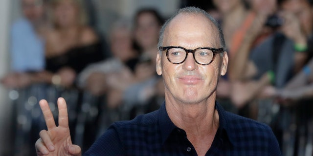 """Michael Keaton poses for photographers upon arrival at the world premiere of the film """"The Beatles, Eight Days a Week"""" on Sept. 15, 2016in London."""