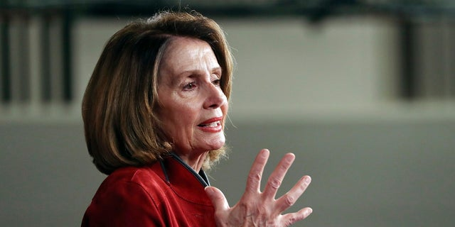 FILE - In this Jan. 11, 2018, file photo, House Minority Leader Nancy Pelosi of Calif., gestures as she speaks during a news conference on Capitol Hill in Washington. On the heels of President Donald Trump's State of the Union address, Pelosi is expected to target the recently approved federal tax overhaul during a town hall-style meeting in Massachusetts. Her appearance at the event in Cambridge on Thursday, Feb. 1, is part of what organizers say is a nationwide tour featuring members of Congress and others to call attention to the Republican tax plan. (AP Photo/Pablo Martinez Monsivais, File)