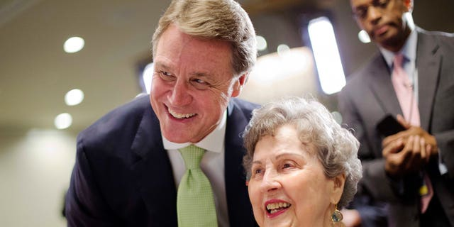 Georgia Republican Sen. David Perdue, left, has emerged as a close Trump ally.