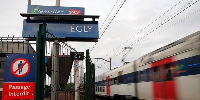 A train starts at the Egly station, south of Paris, Wednesday, May 11, 2016. French authorities opened an investigation Wednesday after a teenage woman allegedly live-streamed video of her suicide on the popular app Periscope. The local prosecutor said the young woman threw herself under a commuter train in the suburban Egly station, south of Paris. (AP Photo/Christophe Ena)