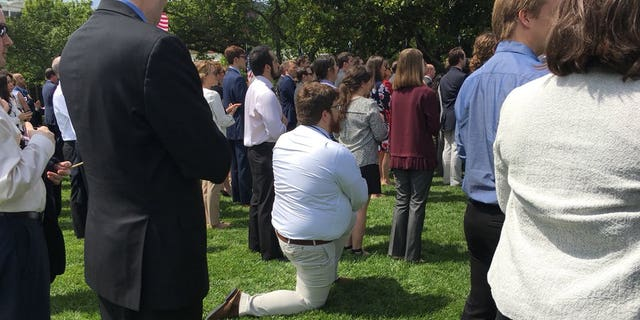 A guest at President Donald Trump's White House event on Tuesday apparently took a knee during the national anthem.