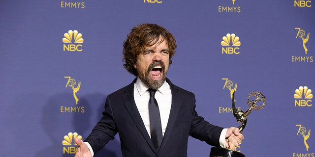Peter Dinklage proudly holds his Emmy/
