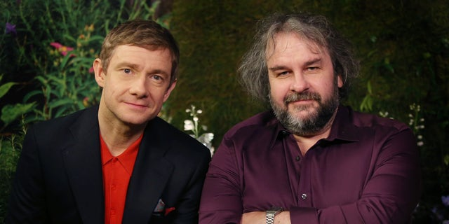 """Monday, Dec. 1, 2014. Actor Martin Freeman and director Peter Jackson from New Zealand poses for photographs in promotion for the film """"The Hobbit, Battle of the Five Armies"""" in the Claridges suite in west London."""