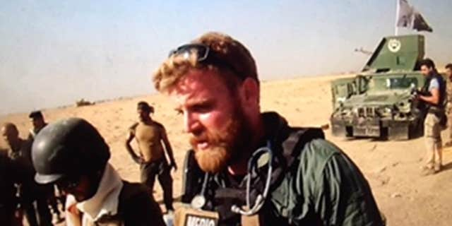 Combat medic Reed north of Mosul on anti-ISIS front line.