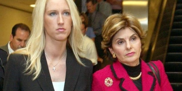 Amber Frey, left, leaves with her attorney Gloria Allred, right, after she testified during the Scott Peterson trial at the Redwood City, Calif., courthouse, Tuesday, Aug. 10, 2004.
