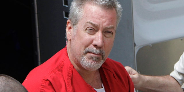 In this May 8, 2009 file photo, former Bolingbrook, Ill., police officer Drew Peterson arrives for court in Joliet, Ill.