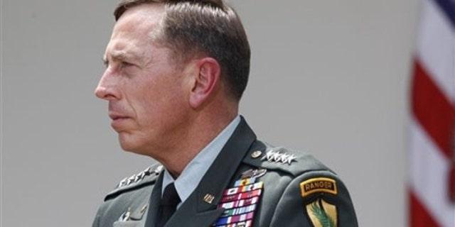 Gen. David Petraeus listens as President Obama makes a statement in the Rose Garden in Washington June 23. (AP Photo)
