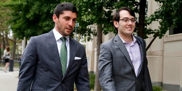 Former biotech CEO Martin Shkreli, right, leaves federal court with a member of his legal team.