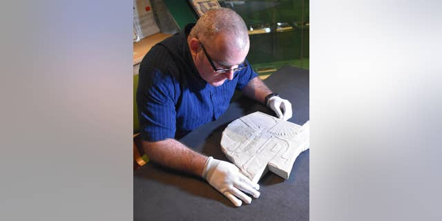 Swansea University Egyptology lecturer Dr Ken Griffin and the newly discovered artifact.