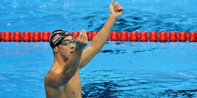 United States' Michael Phelps celebrates after winning the gold medal in the men's 200-meter butterfly final during the swimming competitions at the 2016 Summer Olympics, Tuesday, Aug. 9, 2016, in Rio de Janeiro, Brazil. (AP Photo/Martin Meissner)