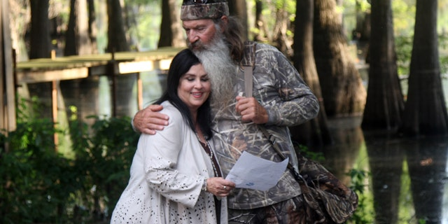 """Phil Robertson and his wife, Miss Kay, in a scene from A&E's """"Duck Dynasty."""""""