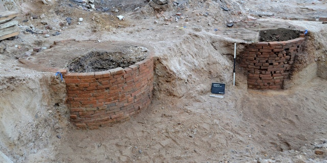 "Two privies during the excavation. ""The Success to the Tryphena"" punch bowl came from the one on the right. (Commonwealth Heritage Group)"