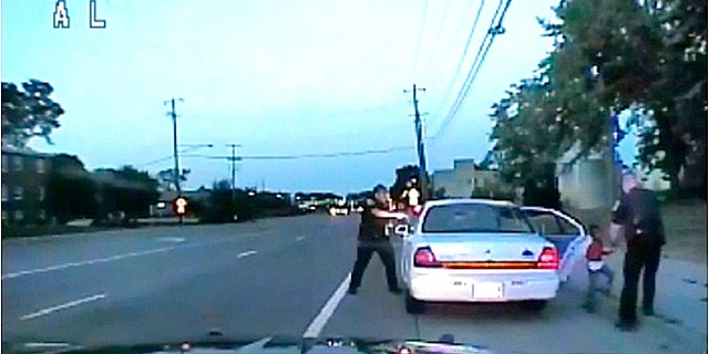 In this image made from July 6, 2016, video captured by a camera in the squad car of St. Anthony Police officer Jeronimo Yanez after shooting into the vehicle at Philando Castile during a traffic stop.