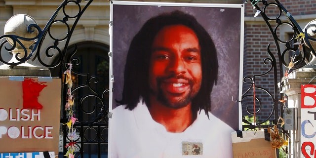 A memorial including a photo of Philando Castile adorns the gate to the governor's residence in St. Paul, Minn. on July 25, 2016.