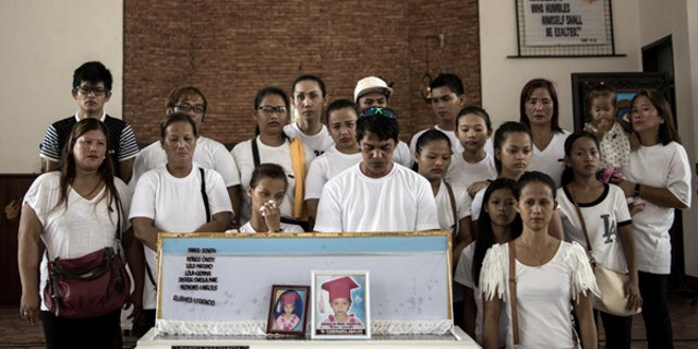 August 31, 2016: A family picture with the coffin of 5-year-old Danica mae Garcia who was killed in front of her family at their home in Dagupan City. An unidentifed gunman was targeting the young girl's grandfather.