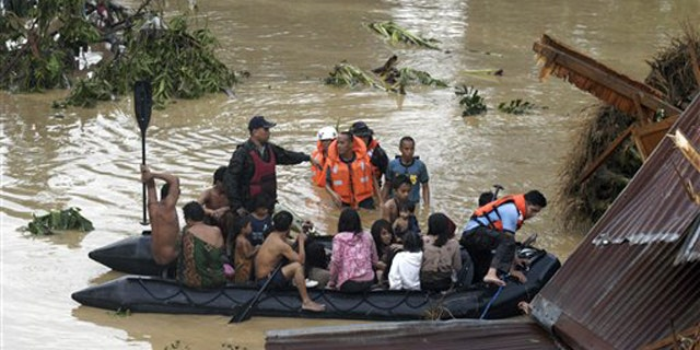 Dec. 17, 2011: Police rescue trapped residents following a flash flood that inundated Cagayan de Oro city, Philippines.