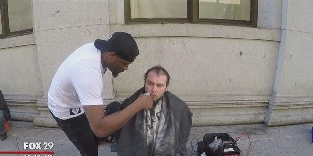 Brennon Jones provides free hair cuts to homeless people in Philadelphia.