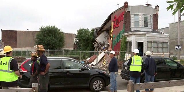 The scene after a row home partially collapsed in Philadelphia.