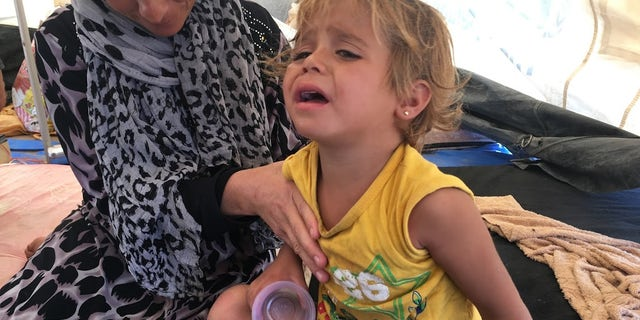 A child weeps at Arisha camp in Hassakeh governorate.