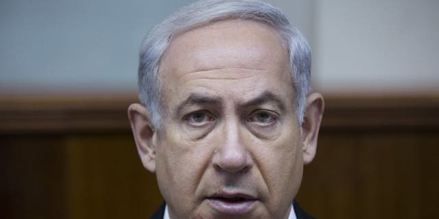 """Israel's Prime Minister Benjamin Netanyahu attends the weekly cabinet meeting on June 16, 2013 in Jerusalem. Netanyahu warned world powers on Tuesday against holding """"drawn out"""" negotiations with Iran on its nuclear programme following the election of a more moderate president in Tehran."""