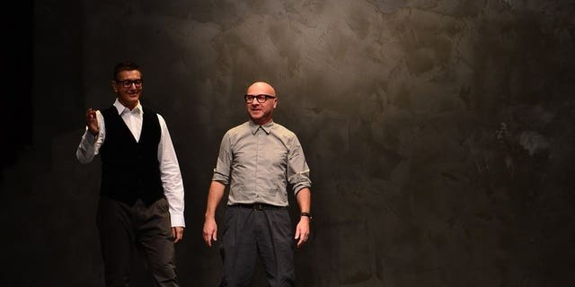Italian designers Stefano Gabbana (L) and Domenico Dolce appear at women's fashion week in Milan on February 24, 2013. An Italian court has sentenced fashion house duo Dolce & Gabbana to one year and eight months in prison for tax evasion of around one billion euros ($1.33 billion), according to media reports.