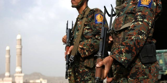 Yemeni soldiers stand guard on August 5, 2012, in Sanaa. Yemeni tribesmen have kidnapped 11 soldiers, including two officers, and are demanding the release of a relative convicted of murder, tribal sources said on Wednesday.