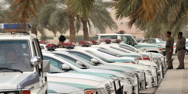 Saudi police cars are parked outside the Al-rajhi mosque in Riyadh, on March 11, 2011. Saudi police have killed a man who fled when they tried to arrest him for allegedly taking part in unrest that shook the kingdom's Shiite-populated Eastern Province last year, according to the official SPA news agency.