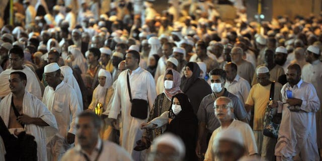 Tens of thousands of Muslim piligrims leave Mecca's Grand Mosque after the evening prayer on November 2, 2011. Twelve Sudanese were killed when a wall collapsed as they waited to submit their applications for the annual hajj pilgrimage, official TV said.