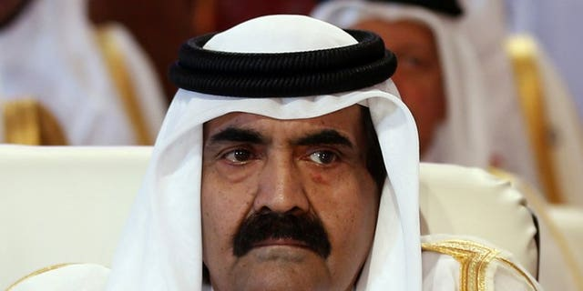 Qatar's Emir Hamad bin Khalifa al-Thani in Doha on March 26, 2013. Sheikh Hamad, who is to hand over to his son on Tuesday after 18 years on the throne, turned the tiny Gulf state from a desert backwater into a major world player.