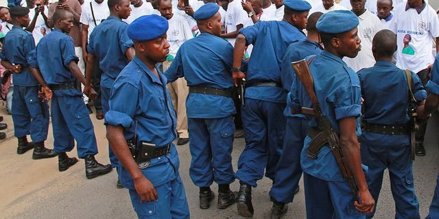 File picture shows police containing protesters in the Burundian capital Bujumbura appealing to end journalist Hassan Ruvakuki's jail sentence, February 19, 2013. A separate Burundian TV journalist arrested 10 days ago on suspicion of breaching state security has been provisionally released, the state prosecutor's office said Tuesday.