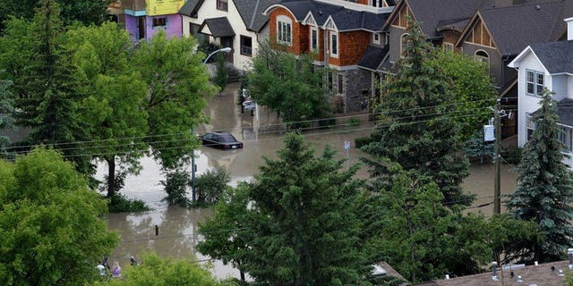 A neighbourhood beside the Bow River in Calgary, Alberta, Canada, is flooded on June 22, 2013. Canadian authorities upped the Alberta flood death toll to four Wednesday, after an autopsy revealed an 83-year-old woman had drowned in her ground-level apartment near the Elbow River.