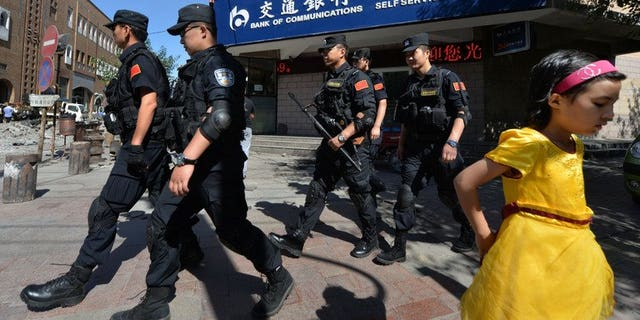Chinese armed police patrol the streets of the Muslim Uighur quarter in Urumqi on Saturday. China staged a large military exercise in the ethnically-divided Xinjiang region on Saturday, an AFP reporter said, where clashes this week killed at least 35 people.