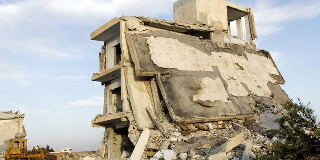 """Destroyed buildings in the village of al-Hamidiyeh, in central Homs province, on June 7, 2013. UN leader Ban Ki-moon has expressed fear for 2,500 """"trapped"""" civilians as Syrian government forces press a campaign to take the city of Homs, a spokesman said."""