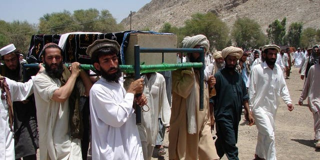 Pakistani tribesmen carry the coffin of a person allegedly killed in a U.S. drone attack, in Miranshah, in 2011. A U.S. drone attack struck a compound of the Al Qaeda-linked Haqqani network, killing at least 17 militants.