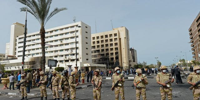 Egyptian soldiers stand guard in front of the Port Said security headquarters on March 8, 2013. Senior military commanders were in emergency talks on Wednesday after Egypt's embattled President Mohamed Morsi rejected their ultimatum to resolve the current crisis, a source close to the military told AFP.