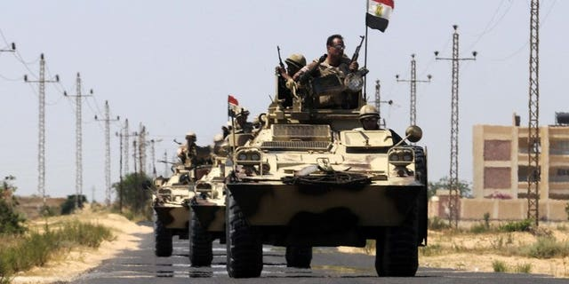 An Egyptian soldier was killed early Friday in coordinated rocket and machinegun attacks by Islamist militants on army checkpoints and a police base in the restive Sinai, medics said. File picture shows Egyptian soldiers on patrol in the Sinai in May