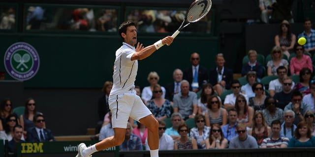 Novak Djokovic makes a return against Juan Martin Del Potro at Wimbledon on Friday. Novak Djokovic won the first set of his Wimbledon semi-final 7-5 against Juan Martin del Potro on Friday.
