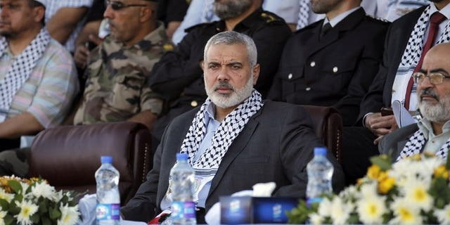 Hamas Prime Minister in the Gaza Strip Ismail Haniya attends a Palestinian Hamas police graduation ceremony in Deir al-Balah in the central Gaza Strip on May 28, 2013. Haniya appealed in a Friday sermon to have faith in the Arab Spring despite the ouster of Egypt's Islamist president Mohamed Morsi by the army.
