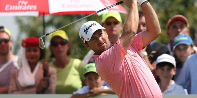 Graeme McDowell of Northern Ireland plays a shot during the final round of the French Open on July 7, 2013 at Le Golf National in Guyancourt, near Paris. McDowell produced a four-under-par final round of 67 to win the Open by four strokes on Sunday.