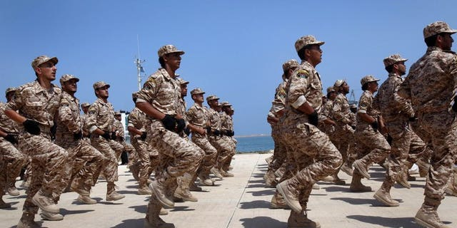 """Libyan soldiers march during their graduation ceremony in Tripoli, on July 3, 2012. Britain is to train up to 2,000 Libyan troops in a bid to """"help them achieve peace and stability across their country"""", the British defence ministry announced"""