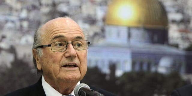 FIFA President Sepp Blatter speaks in the West Bank city of Ramallah on July 7, 2013. Blatter urged Israel on Tuesday to ease restrictions on the movement of Palestinian players and officials that have long dogged the development of football in the West Bank and Gaza Strip.