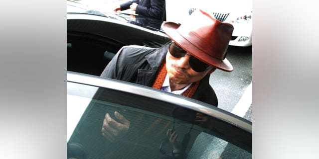 Kenichi Shinoda, the boss of Japan's largest yakuza gang, the Yamaguchi-gumi, gets into a car in Kobe, on April 9, 2011.